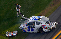 Feb 23, 2013; Daytona Beach, FL, USA; NASCAR Nationwide Series Kyle Larson (32) driver walks away from the remains of his car after crashing on the last lap of the DRIVE4COPD 300 at Daytona International Speedway.