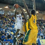 Delaware Guard Devon Saddler (10) shoots over two George Mason defenders in the Second half of a regular season NCAA basketball game against George Mason Saturday, March 2, 2013 at the Bob Carpenter Center in Newark Delaware.