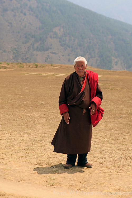 Asia, Bhutan, Punakha. Bhutanese man in traditional dress, or gho.