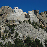 The Mount Rushmore National Memorial, near Keystone, South Dakota, is a monumental granite sculpture by Gutzon Borglum. The monument represents the first 150 years of the history of the United States of America with 60-foot (18m) sculptures of the heads of former United States presidents (left to right): George Washington, Thomas Jefferson , Theodore Roosevelt, and Abraham Lincoln. The entire memorial covers 1,278.45acres (5.17km2) and is 5,725feet (1,745m) above sea level.