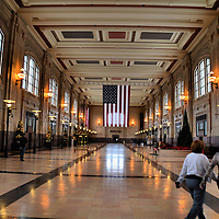 North Waiting Room of Kansas City Union Station in Kansas City, Missouri<br /> Trains were the premier way to travel during the Golden Age of Railroading (1900 -1950). The Pullman company made elaborate sleeper, dining, parlor and passenger cars. This fifty year period also witnessed the building of grand-scale stations such as NYC&rsquo;s Grand Central Terminal.  In 1914, the country&rsquo;s second largest opened with lots of marble, ornate detail and three chandeliers weighing 3,000 each: Kansas City Union Station. After WWII, railroading declined and so did the K.C. station until. It closed in 1985. After a $250 million renovation, the former Union Station now houses museums, theaters and restaurants. Locals use the polished floors as a walking track for exercise during inclement weather.
