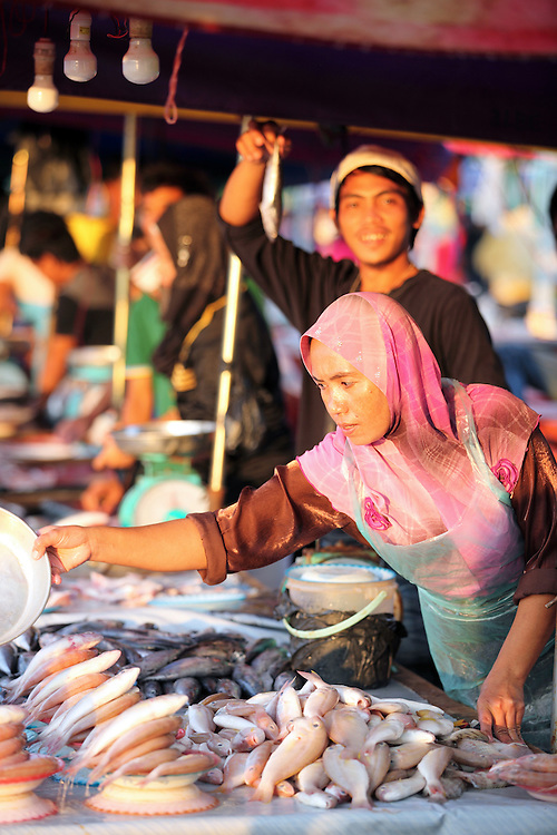 Vendors at Kota Kinabalu wet market on the waterfront.