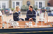 Olympic and America's Cup winning sailor, Sir Ben Ainslie, aboard his yacht Rita with girlfriend Georgie Thompson on the opening day of Aberdeen Asset Management Cowes Week. The pair sat on deck as the competitors finished racing on the opening day of the regatta. The event began in in 1826 and plays a key part in the British sporting summer 'season'. It now stages up to 40 daily races for around 1,000 boats and is the largest sailing regatta of its kind in the world with 8,500 sailors competing.<br /> Picture date Saturday 2nd August, 2014.<br /> Picture by Christopher Ison. Contact +447544 044177 chris@christopherison.com