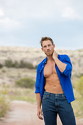 man with an open shirt outdoors in the desert of New Mexico