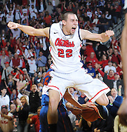 "Mississippi's Marshall Henderson (22) celebrates after dunking against Florida at the C.M. ""Tad"" Smith Coliseum in Oxford, Miss. on Saturday, February 22, 2014. (AP Photo/Oxford Eagle, Bruce Newman)"