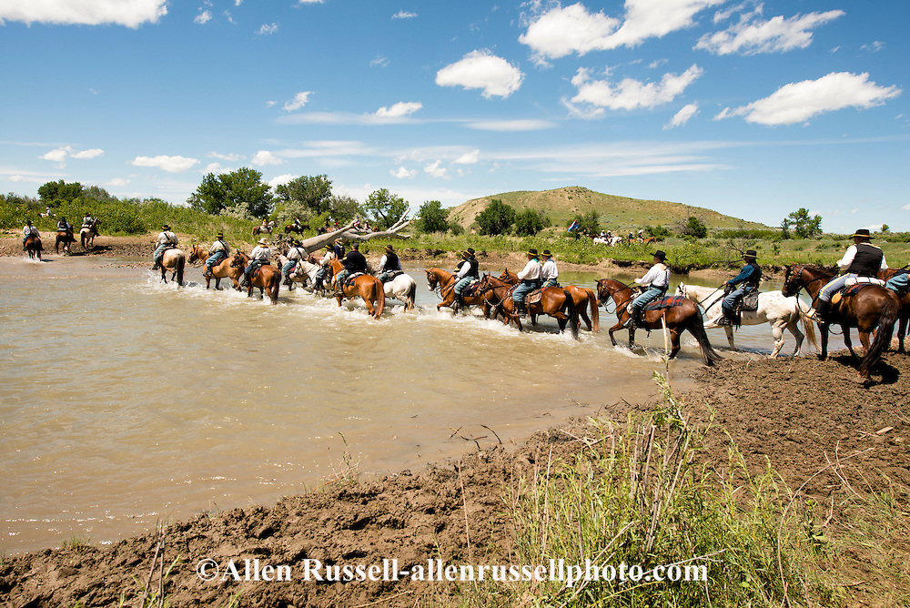 Battle of the Little Bighorn Reenactment,<br /> Custers Last Stand, Montana, General Custer leads 7th Cavalry across Little Bighorn