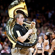 SHOT 1/21/12 6:45:12 PM - A Colorado Golden Marching Band tuba player performs during the game against Arizona at the Coors Events Center in Boulder, Co. Colorado won the game 64-63..(Photo by Marc Piscotty / © 2012)