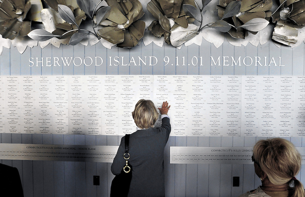 Eileen Lawrence of Weston, Conn., touches the name of her son Robert Lawrence at a new memorial dedication marking the 10th anniversary of the Sept. 11, 2001, terrorist attacks that killed 152 people with ties to Connecticut at Sherwood Island State Park in Westport, Conn., Thursday, Sept. 8, 2011.   Lawrence worked in the World Trade Center. (AP Photo/Jessica Hill)