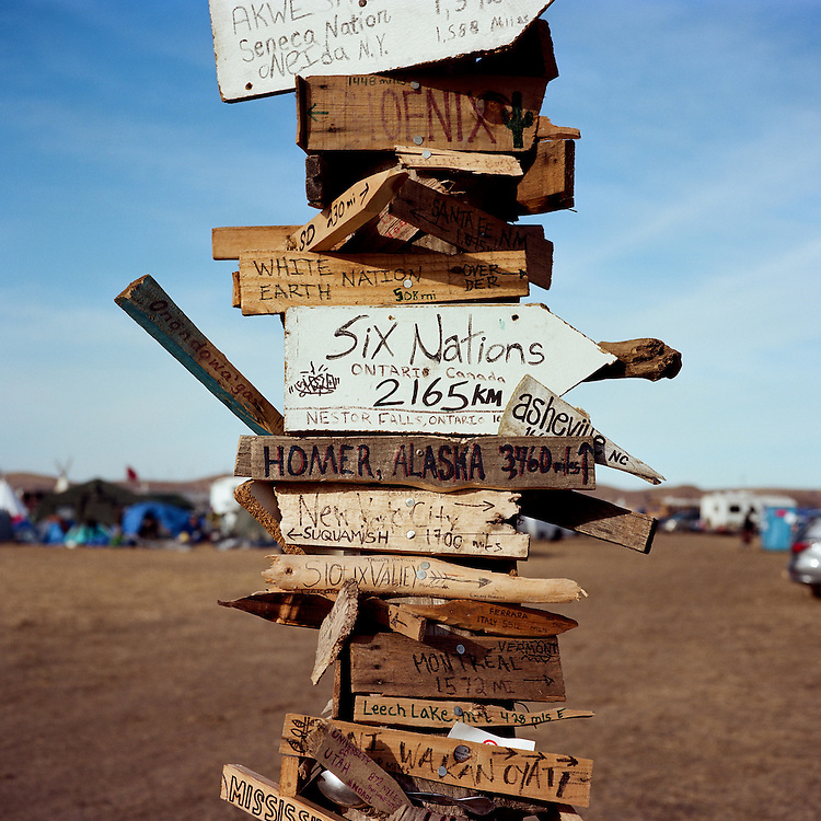 OCETI SAKOWIN CAMP, CANNON BALL, NORTH DAKOTA - NOVEMBER 25, 2016: A post in the Oceti Sakowin Camp in Cannon Bell, North Dakota, has been signed by water protectors with where they have come from to protest the Dakota Access Pipeline.