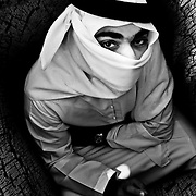 """Where is the Exit?"" by Reem Al Falahi. Arab man with his face covered and enclosed by walls that surround him."
