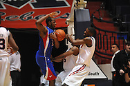"SMU's Robert Nyakundi (24) crashes into Ole Miss' Dundrecous Nelson (5) and Ole Miss' Terrance Henry (1) at the C.M. ""Tad"" Smith Coliseum in Oxford, Miss. on Tuesday, January 3, 2012."