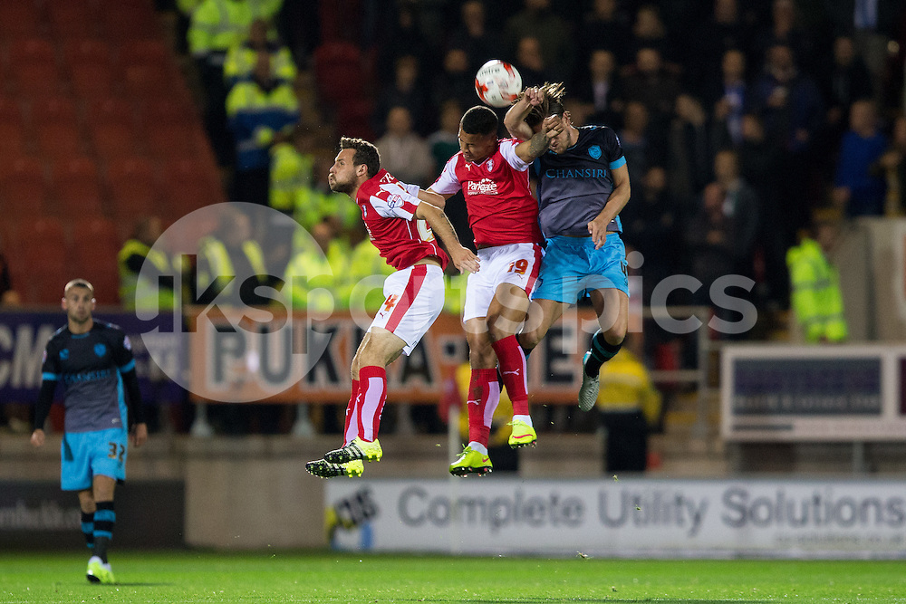 Danny Collins of Rotherham United and Jonson Clarke-Harris of Rotherham United go up for a header with Sam Hutchinson of Sheffield Wednesday during the Sky Bet Championship match between Rotherham United and Sheffield Wednesday at the Aesseal New York Stadium, Rotherham, England on 23 October 2015. Photo by James Williamson.