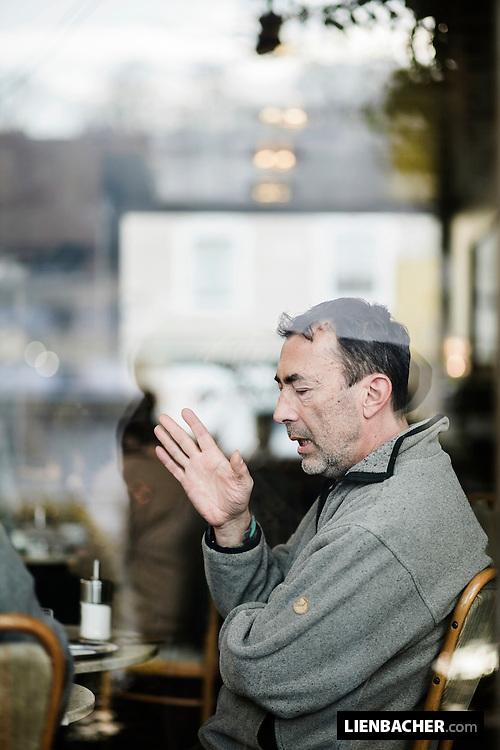 Portrait of Hubert during an interview in the Cafe Bazar in Salzburg