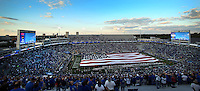 Fans in Commonwealth Stadium honor the American flag before the University of Kentucky football team takes on Kent State in Lexington, Ky. on 9/9/12. Photo by David Stephenson