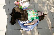 """Jenny Dyer, 19, waits in line for an open casting session for season 11 of """"The Biggest Loser"""" television show studies the application for the show in Broomfield, Colorado July 17, 2010. Over 600 people, many spending the night on the sidewalk outside the hall applied for a chance to be on the show and win $250,000.  REUTERS/Rick Wilking (UNITED STATES)"""