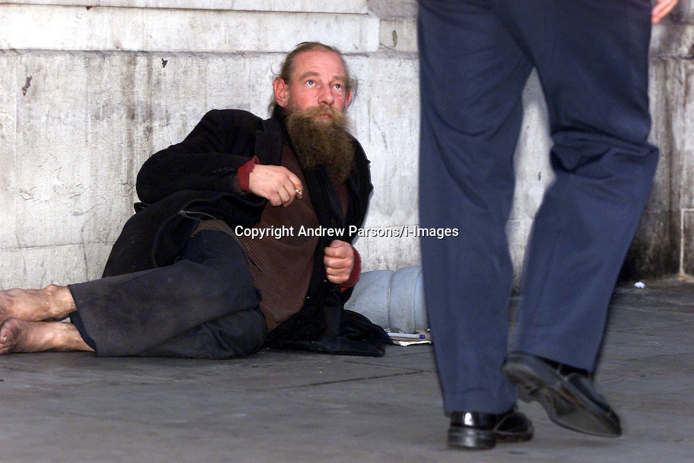 Homeless person in Regent Street, London. Photo by Andrew Parsons/i-Images.All Rights Reserved ©Andrew Parsons/i-images.See Instructions.