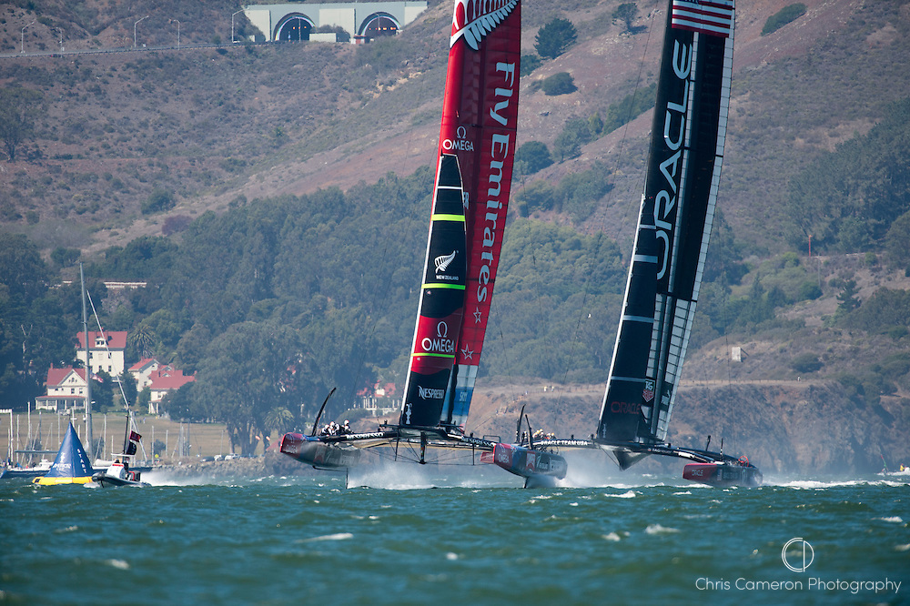 Emirates Team New Zealand NZL5 leads Oracle Team USA in leg one of race 11 on day eight of America's Cup 34. 18/9/2013