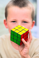 Young Boy Holding a Rubik's Cube Puzzle