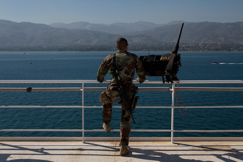 MA3 Hootman keeps watch on the USNS Comfort, a U.S. Naval hospital ship, on January 21, 2010 in Port-au-Prince, Haiti. The Comfort deployed from Baltimore with 550 medical personnel on board to treat victims of Haiti's recent earthquake, and arrived on January 20.