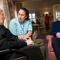UK. Anchor Trust, Bracknell. .Photo shows Fedora Munt, Senior Care Assistant, with Ernie and Alice Baldwin at the Heathlands Day Centre.