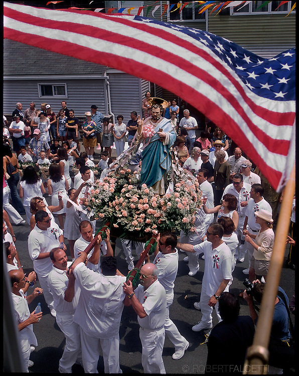 GLOUCESTER, MA- JUNE 29, 2003:  The statue of St. Peter is carried through the streets after Mass on Fiesta Sunday during the annual celebration paying homage to St. Peter, the patron saint of fishermen in Gloucester, MA. The festa takes place on the weekend closest to the Feast Day of St. Peter, June 29. .(Photo by Robert Falcetti) . .