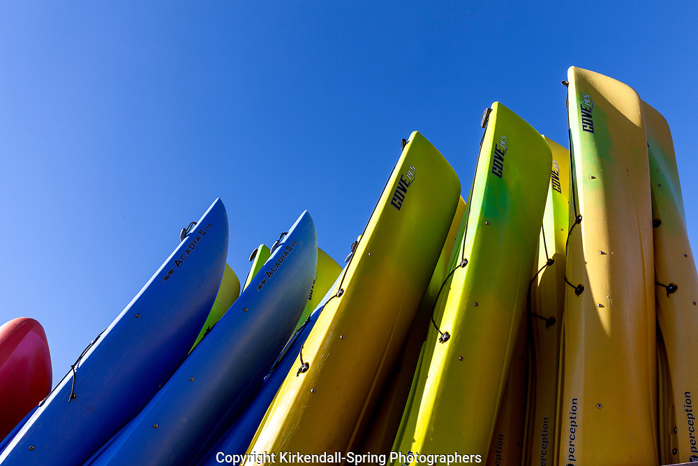 NC00831-00...NORTH CAROLINA - Kayaks stacked up in the town of Hatteras on the Outer Banks.
