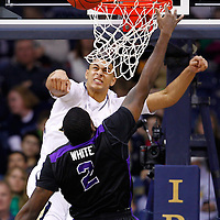 SOUTH BEND, IN - DECEMBER 21: Zach Auguste #2 of the Notre Dame Fighting Irish rejects the shot of Devon White #2 of the Niagara Purple Eagles at Purcel Pavilion on December 21, 2012 in South Bend, Indiana. (Photo by Michael Hickey/Getty Images) *** Local Caption *** Zach Auguste; Devon White
