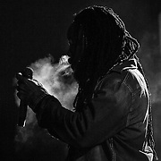 07/30/11 Wilmington DE: Reggae Artist Bushman lights up a Joint on stage while performing live at The Bob Marley 17th Annual Peoples Festival Saturday, July 30, 2011, at Tubman-Garrett Riverfront Park in Wilmington Delaware.<br />