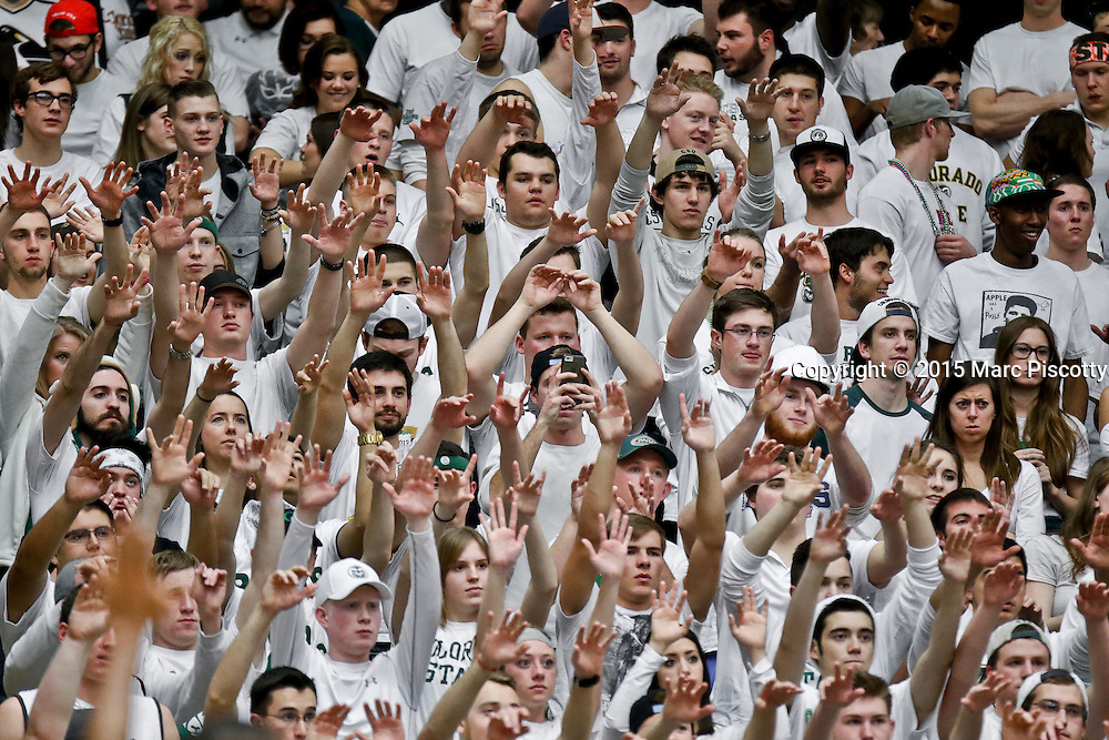 """SHOT 1/24/15 10:14:30 PM - Colorado State basketball fans try to distract a San Diego State player at the free throw line during a """"White Out"""" night regular season Mountain West basketball game at Moby Arena in Fort Collins, Co. Colorado State won the game 79-73. (Photo by Marc Piscotty / © 2015)"""