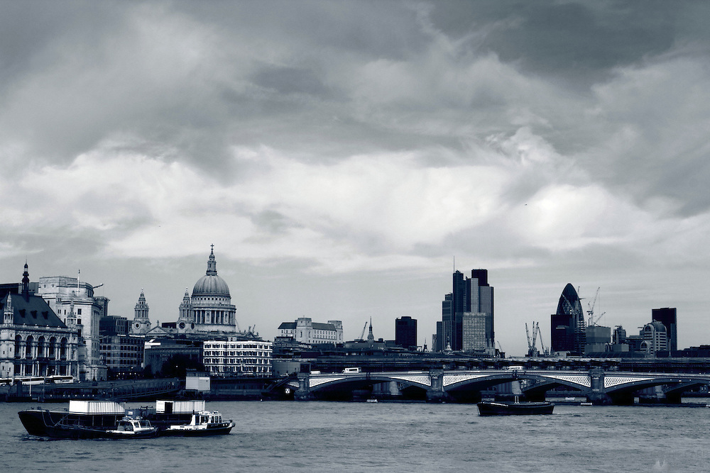 Clouds over the City of London - blue monochrome