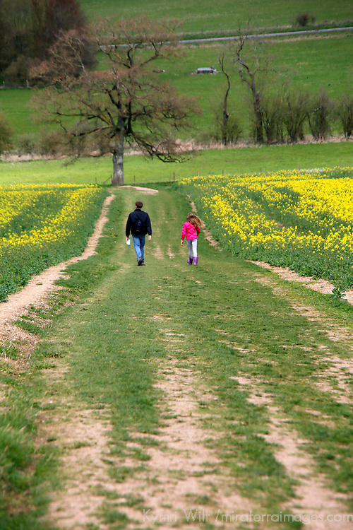 Europe, Great Britain, England, Avebury. People on path down from West Kennet Longbarrow, a UNESCO World Heritage Site.