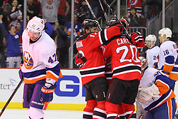 Jan 31, 2013; Newark, NJ, USA; The New Jersey Devils celebrate a goal by New Jersey Devils center Ryan Carter (20) during the second period at the Prudential Center.