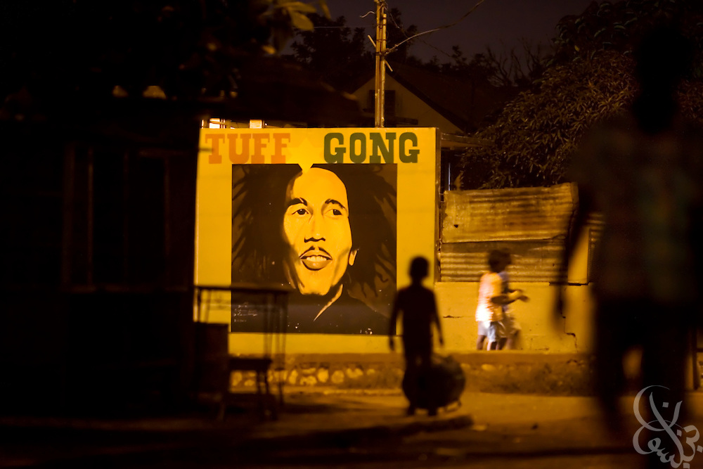 A mural of reggae hero Bob Marley adorns a wall in the Rema garrison December 26, 2008 in Kingston, Jamaica. Marley made the area around Rema, called Trench Town, famous in many of his songs, and plans have been proposed to capitalize on the area's fame through tourism, although current levels of violence make them impractical for now.