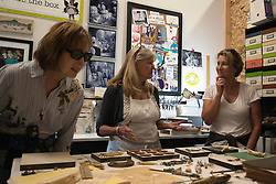 Belinda Isley (L to R: Sara Hill, Belinda Isley, Ann Guardiola) in her studio with her work-in-process assembly collages.<br /> <br /> Jodi Eichelberger's ST(r)EAM Artist Studio/Gallery bike tour in the Surel Mitchell Live-Work-Create District in Garden City, Idaho on June 18, 2016.<br /> <br /> Tour started at the studios of Susan Madacsi, April VanDeGrift, Erin Cunningham, and continued to Ken McCall Studios, James &amp; Matt Wilson of Red Valley Mandolins, Arin Arthur, Angie Bowling Sebolt, Belinda Isley, Matt Herberg, Lisa Roggenbuck and the Visual Arts Collective.
