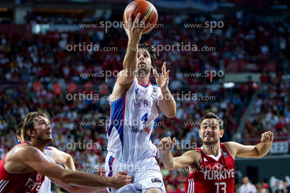 Milos Teodosic of Serbia between Semih Erden of Turkey and Ender Arslan of Turkey during the second semifinal basketball match between National teams of Serbia and Turkey at 2010 FIBA World Championships on September 11, 2010 at the Sinan Erdem Dome in Istanbul, Turkey. Turkey defeated Serbia 83 - 82 and qualified to finals.  (Photo By Vid Ponikvar / Sportida.com)
