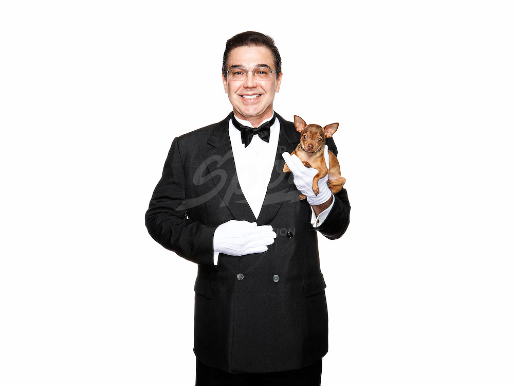 Professional butler, Edward Ordonez is photographed with his teacup chihuahua, Tuesday, July 26, 2011 in Houston, Texas. Ordonez takes care of several chihuahua's for clients. (Todd Spoth for the Chronicle)