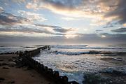 NC00815-00...NORTH CAROLINA - Sunrise over the Atlantic Ocean at Cape Hatteras Lighthouse, Cape Hatteras National Seashore.