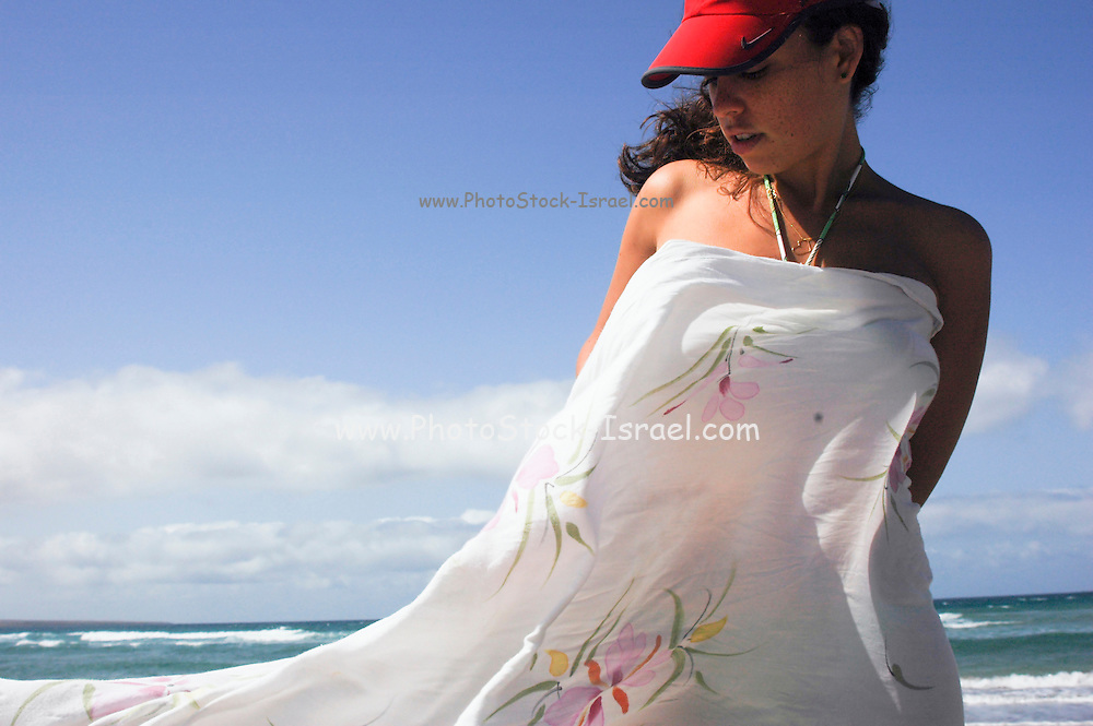 Woman in beach clothing at a summer holiday resort Model Release available