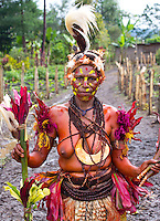 Portrait of a woman from the Selehoto Alunumuo Sing sing group. She is dressed in traditional tribal dress for the Goroka Show, an annual Singsing Festival in the highlands of Papua New Guinea