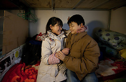 Members of 'Longzaitian' or 'Dragon in the Sky' Shadow Puppet TroupeTao Peng (R) and his wife Li Jiahui, both 23, share an intimate moment in their old dormitory in Beijing, China 29 January 2013. The couple were newly wedded in a mass wedding in December last year. They now live in a hotel room which is provided by a sponsor to them for three months but worry what they are to do when the three months are up as they have no money to buy a home of their own. 'Longzaitian' or 'Dragon in the Sky' Shadow Puppet Troupe consists of close to 50 members who look like children but are actually dwarfs with an average age of 22 and height of 1.26 metres. Formed in 2008, the troupe started out with less than ten members but gradually grew in fame and stature, drawing many other dwarfs from all parts of China who seek to be accepted in a community of their own. The troupe provides training, food, accommodation and income for the members as well as a sense of belonging and pride in their work preserving the ancient art of shadow puppetry. Dwarfs have traditionally been viewed as disabled people in China and are often discriminated by mainstream society.