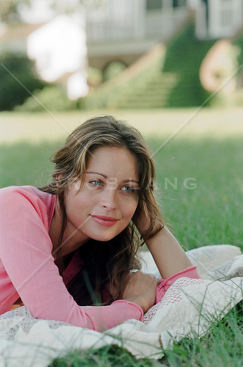 woman relaxing on a blanket on a grassy backyard in South Carolina