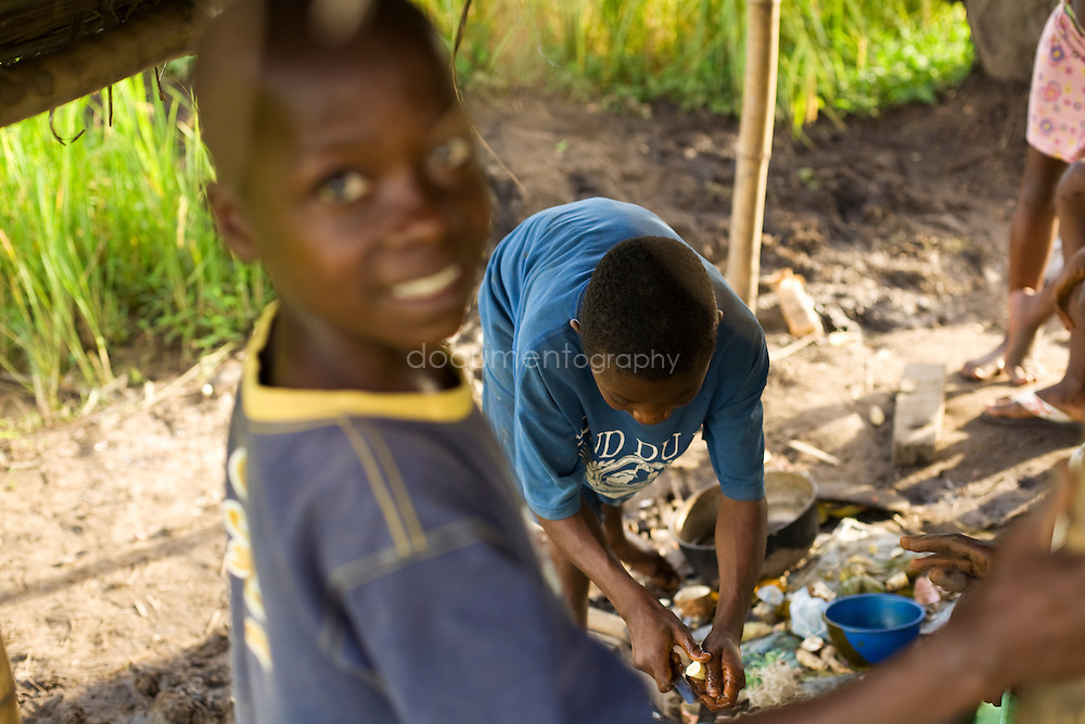 Children cooking while looking after the rice fields, Kingsville #7, Liberia.