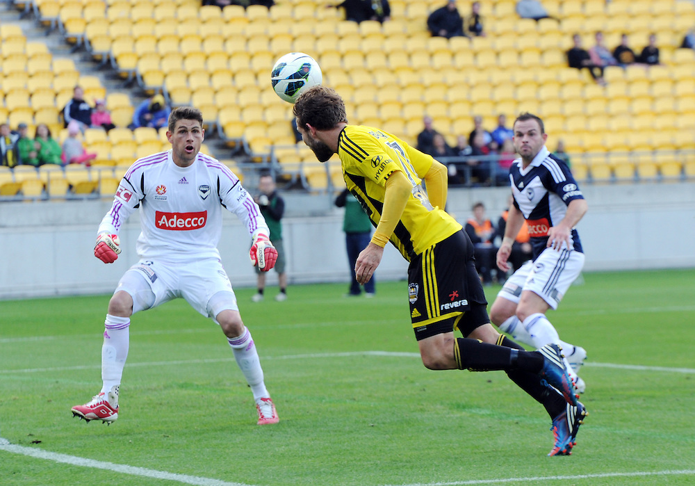 Phoenix's Jeremy Brockie, right, attempts a header past the Melbourne Victory FC's goal keeper Nathan Coe in the A-League football match at Westpac Stadium, Wellington, New Zealand, Sunday, March 31, 2013. Credit:SNPA / Ross Setford