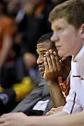 SHOT 2/26/11 5:08:25 PM - Texas' Jai Lucas (#10) watches the closing minutes of a loss to Colorado during their regular season Big 12 basketball game at the Coors Events Center in Boulder, Co. Colorado upset the fifth ranked Texas 91-89. (Photo by Marc Piscotty / © 2011)