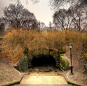 A bridge overpass in Central Park on a rainy day.