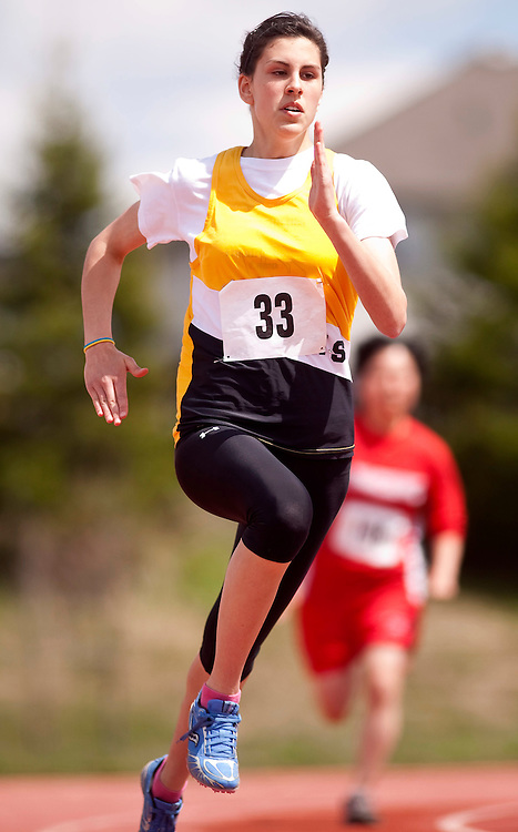 St.Thomas, Ontario ---11-05-07--- Sarah Muma of Central Elgin competes in the 200 metres at the 2011 Kettle Creek Invitational at St. Joe's in St.Thomas, Ontario, May 7, 2011. <br /> GEOFF ROBINS/Mundo Sport Images