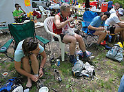 Runners refuel and rest up at the Gap Creek Trail Head aid station at mile 38.9 during the  Massanutten Mountain Trails 100 Mile run (MMT 100) May 17, 2008..The aid stations provided at the MMT 100 are considered some of the best in the sport. .The  MMT 100 is considered one of the toughest Ultra Marathons on the east coast. The  Massanutten Mountain Trails 100 Mile run (MMT 100) May 17, 2008.<br /> The  race is considered one of the toughest Ultra Marathons on the east coast.