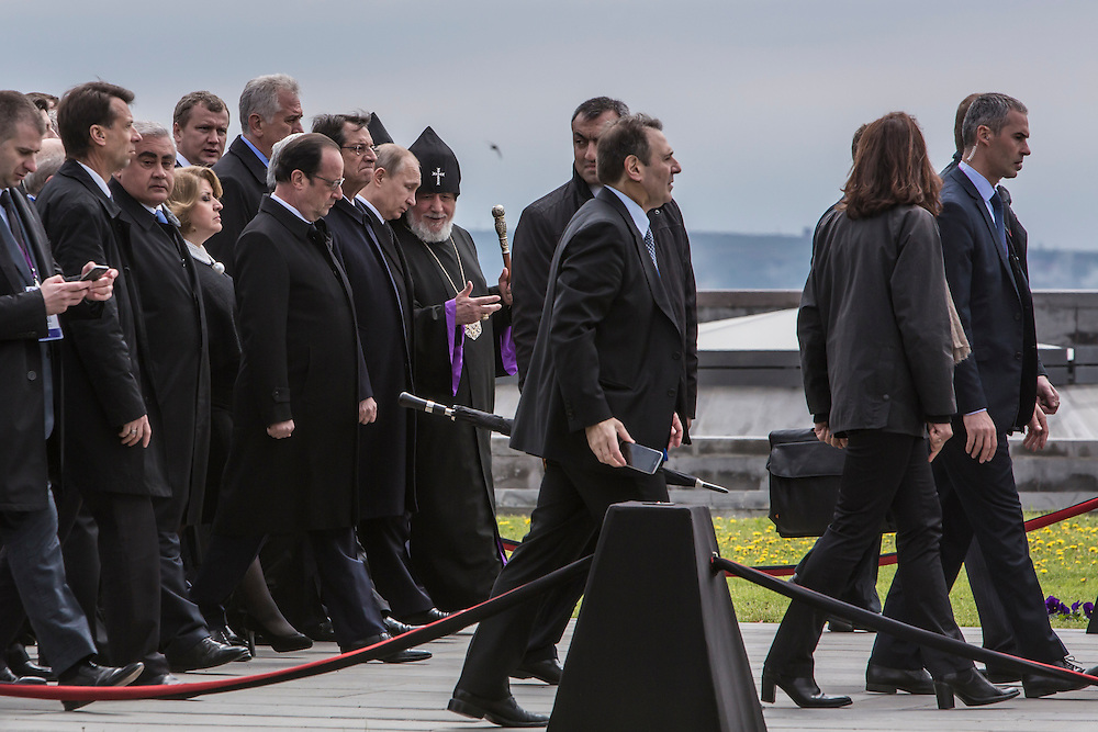 YEREVAN, ARMENIA - APRIL 24: President Vladimir Putin of Russia, President Francois Hollande of France, and other officials depart after a commemoration ceremony at the Armenian genocide memorial on April 24, 2015 in Yerevan, Armenia. Armenians today are marking the one hundredth anniversary of events generally considered to be the start of a campaign of genocide against minority ethnic Armenians living in present-day eastern Turkey by the Ottoman government over fears of their allegiance during World War I. (Photo by Brendan Hoffman/Getty Images) *** Local Caption *** Vladimir Putin;Francois Hollande