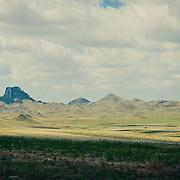 short grass prairie of eastern and central montana, bird tail butte under summer clouds conservation photography - montana wild prairie