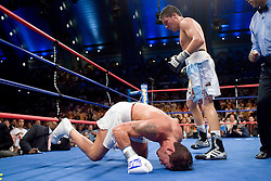 July 22, 2006 - Carlos Baldomir stands over fallen Arturo Gatti during the ninth round their 12 round fight for the WBC Welterweight Championship at Boardwalk Hall in Atlantic City, NJ.  Baldomir retained his title via 9th round stoppage.